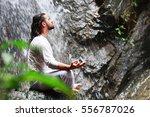 man sitting in meditation yoga... | Shutterstock . vector #556787026