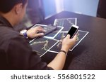 young businessman using a phone ... | Shutterstock . vector #556801522