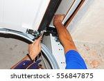 contractor repair garage door... | Shutterstock . vector #556847875