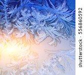 ice patterns on winter glass | Shutterstock . vector #556860592