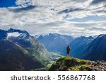 Hiker on the mountain top. Sport and active life concept. Hiking ROMSDALSEGGEN RIDGE, Andalsnes City, Norway - stock photo