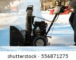 a man cleans snow from...   Shutterstock . vector #556871275