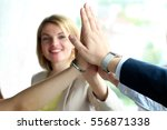 happy business team giving high ... | Shutterstock . vector #556871338