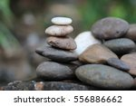 stones arranged vertically | Shutterstock . vector #556886662