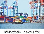 tugboat and crane in harbor... | Shutterstock . vector #556911292