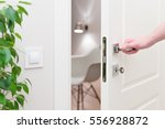 to open the door. modern white... | Shutterstock . vector #556928872