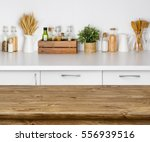 brown wooden table with bokeh... | Shutterstock . vector #556939516