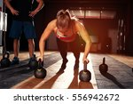 muscular blonde girl doing push ... | Shutterstock . vector #556942672
