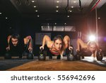 young muscular athletes doing... | Shutterstock . vector #556942696