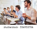 start up team clapping hands of ... | Shutterstock . vector #556953706