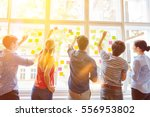 students putting sticky notes... | Shutterstock . vector #556953802