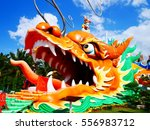 colorful dragon head statue  | Shutterstock . vector #556983712