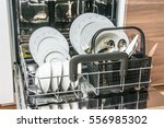 open dishwasher with clean... | Shutterstock . vector #556985302