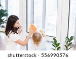 happy family doing the house... | Shutterstock . vector #556990576