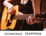 woman's hands playing  acoustic ... | Shutterstock . vector #556990936