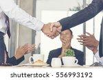 teamwork shake hands with... | Shutterstock . vector #556993192