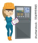 woman working on control panel. ...   Shutterstock .eps vector #556995985