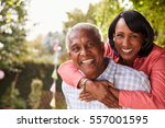 senior black couple piggyback... | Shutterstock . vector #557001595