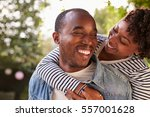 smiling young black couple... | Shutterstock . vector #557001628