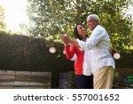 senior black couple dancing in... | Shutterstock . vector #557001652