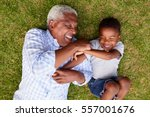 grandfather and grandson play... | Shutterstock . vector #557001676