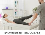 physiotherapist working with... | Shutterstock . vector #557005765