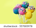 Colorful Cake Pops On A Yellow...