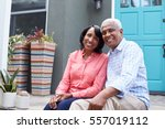 senior couple sit on steps... | Shutterstock . vector #557019112