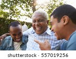 senior man talking with his... | Shutterstock . vector #557019256