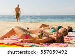 Three Girls Sunbathing On The...