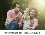 portrait of cheerful family... | Shutterstock . vector #557073316