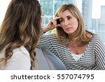 worried mother talking to... | Shutterstock . vector #557074795