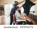 barber put a sheet to cover his ... | Shutterstock . vector #557076772