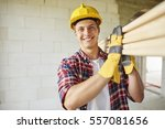 younger carpenter holds wooden... | Shutterstock . vector #557081656