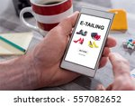 Small photo of Male hand holding a smartphone with e-tailing concept