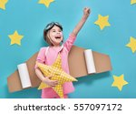 little child girl in an... | Shutterstock . vector #557097172