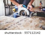 carpenter using circular saw... | Shutterstock . vector #557112142