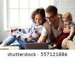 young happy family relaxing at... | Shutterstock . vector #557121886