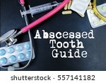 Small photo of Abscessed Tooth Guide word, medical term word with medical concepts in blackboard and medical equipment.