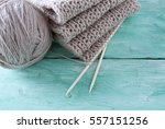 knitted scarf on turquoise... | Shutterstock . vector #557151256