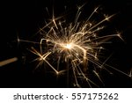 fire sparklers on black... | Shutterstock . vector #557175262
