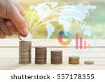 hand put money on pile of coins ... | Shutterstock . vector #557178355