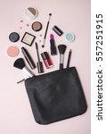 a black leather make up bag ... | Shutterstock . vector #557251915