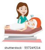 cosmetologist applying cosmetic ... | Shutterstock .eps vector #557269216