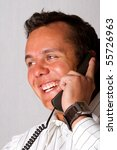 A happy man talking on a telephone - stock photo