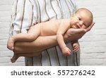 baby in man's hand. white... | Shutterstock . vector #557276242