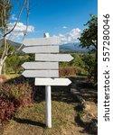 white wooden signpost arrows... | Shutterstock . vector #557280046
