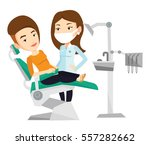 woman sitting in dental chair... | Shutterstock .eps vector #557282662