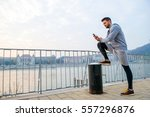 a handsome young man putting... | Shutterstock . vector #557296876