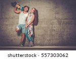 cheerful couple with with... | Shutterstock . vector #557303062